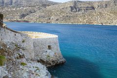 Fragment of a defense tower and walls in the Spinalonga fortress. Sea view from the leper island in Greece.  stock photo