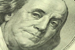 A fragment of a denomination of one hundred dollars with a portrait of Benjamin Franklin Royalty Free Stock Images