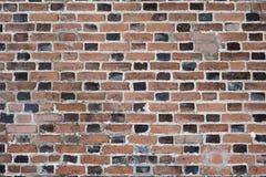 Fragment der alten Backsteinmauer mit mehrfarbigen Ziegelsteinen und Tönen, Hintergrund Lizenzfreie Stockbilder