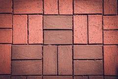 Fragment des Bürgersteigs des roten Lehms für Hintergrund getont Lizenzfreie Stockbilder