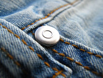 Fragment des jeans mode par classique Photographie stock libre de droits