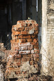 A fragment of the destroyed brick building Stock Photography