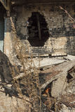A fragment of the destroyed brick building Stock Images
