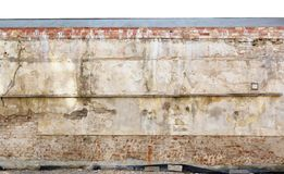 Fragment of the destroyed  centenary monastery wellow wall and f Royalty Free Stock Images