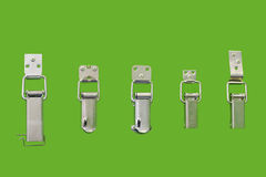 A fragment of different types of simple mechanical locks-latches. Different types of simple mechanical locks-latches to securely close boxes of any size Stock Photography