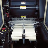 Fragment of digital offset machine with paper ready for printing Stock Image