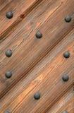Fragment of a door. With metal rivets Stock Photos