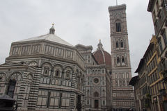 The fragment of Duomo Santa Maria del Fiore, Baptistery of San Giovanni and Giotto`s Bell tower, Florence, Italy Royalty Free Stock Photography