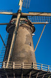 Fragment of Dutch old windmill in Holland agaisnt blue sky Stock Images
