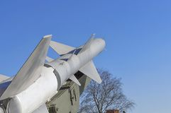 Fragment of the earth-air rocket against the blue sky. A missile system on courtyard of Military History Museum of artillery, engineer and signal corps in St Stock Photography