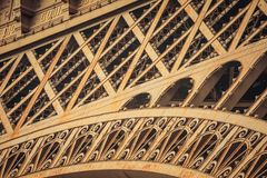 Fragment of Eiffel Tower, low level. The most popular landmark of Paris, France. Royalty Free Stock Photography