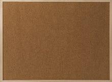 Fragment einer braunen Korkenbeschaffenheit im Holzrahmen Lizenzfreie Stockfotos