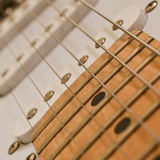 Fragment of the electric guitar Royalty Free Stock Image