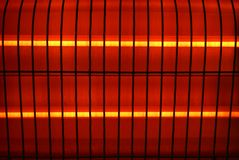 Fragment of an electric heater. Fragment of a household electric heater with the heated spirals Royalty Free Stock Photos