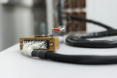 Fragment of electrical cable with rectangular multi-pin connector. Royalty Free Stock Photo