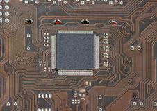 Fragment of electronic board with chip in center closeup Stock Photography