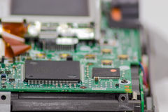 Fragment of electronic device with chips in foreground closeup Stock Photo