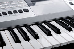 Fragment of electronic synthesizer keyboard with control buttons Stock Image