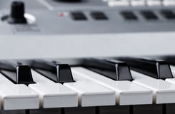 Fragment of electronic synthesizer keyboard with control buttons Royalty Free Stock Photo
