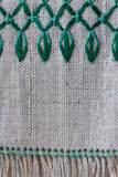 Fragment of embroidered ornament on linen napkin Stock Image