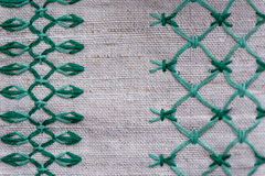 Fragment of embroidered ornament on linen napkin Stock Images