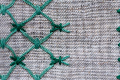 Fragment of embroidered ornament on linen napkin Royalty Free Stock Photography