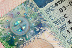 Fragment of European Schengen Visa in a passport page Royalty Free Stock Images