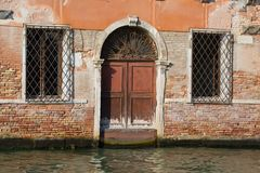 Fragment of the façade of the flooded old house. Venice, Italy. Fragment of the façade of the flooded old house. Venice. Italy royalty free stock images