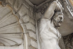 Fragment of a facade of a building. Telamon. The sculpture supporting designs of a balcony Stock Photo