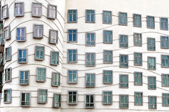 Fragment of the facade of the Dancing House in Prague. Royalty Free Stock Photos