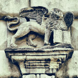 Fragment of facade decor in Lviv  - Griffon with book Royalty Free Stock Image