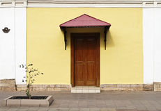 Fragment of the facade of the house to the front door Stock Image
