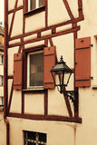 Fragment of facade of medieval house with lantern Stock Images