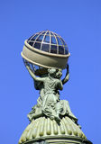 Fragment of a facade. Saint-Petersburg. Fragment of a facade. Statue of a Greek holding a globe Stock Image