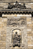 Fragment of facade with sculptures Stock Photos