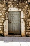 Fragment of the facade of a stone house with a door in Croatia. Vertical Stock Image
