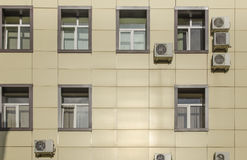 A fragment of the facade wall with windows of the building. Royalty Free Stock Images