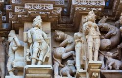Fragment of the famous erotic temple in Khajuraho. Stone carved - fragment of the famous erotic temple in Khajuraho, Chhatarpur district of Madhya Pradesh, India Stock Photo