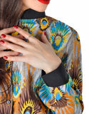Fragment of female attire. Variegated blouse. Fragment of female attire. Variegated blouse and manicured hands of the girl Stock Photography