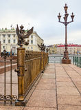A fragment of the fence of Alexander Column and a lantern at the Dvortsovaya Palace square. Stock Photography