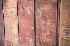 A fragment of a fence made of old brown polished boards and planks.Old wooden surface.Texture, background, close up. Wooden plank royalty free stock photography