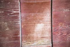 A fragment of a fence made of old brown polished boards and planks.Old wooden surface.Texture, background, close up. Wooden plank stock image