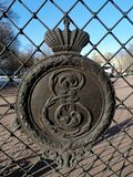 A fragment of the fence of the Park with the Royal crown and patterns royalty free stock photo