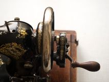 Fragment of first hand SINGER sewing machine, flywheel, selective focus royalty free stock photography