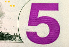 Fragment of five dollar bill Stock Photos