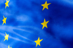 Fragment of a flag of  European Union in sunlight Royalty Free Stock Photos