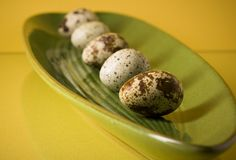 Fragment of flat ceramic dish with quail eggs Stock Photo
