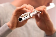 Fragment of flute in the hands of a musician Stock Photo