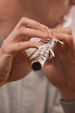 Fragment of flute in the hands of a musician Stock Photos