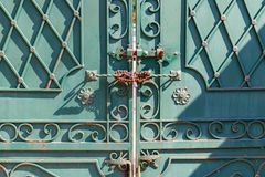 Fragment forged iron gate closed with a padlock closeup Royalty Free Stock Photo